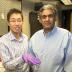 From left: Sungjae Ha and Anantha Chandrakasan demonstrate the chip in the Nanomechanics Laboratory. Photo: Patricia Sampson/EECS