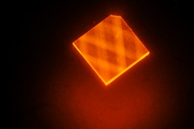 "In this image, laser light enters a synthetic diamond from a facet at its corner and bounces around inside the diamond until its energy is exhausted. This excites ""nitrogen vacancies"" that can be used to measure magnetic fields. image: H. Clevenson/MIT Lincoln Laboratory"