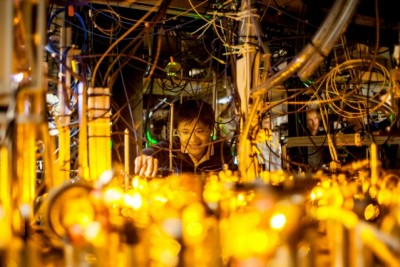 Graduate student Lawrence Cheuk adjusts the optics setup for laser cooling of sodium atoms.  Photo: Jose-Luis Olivares/MIT