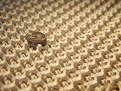 The gyroid surface with a dime on top. Image: Ling Lu and Qinghui Yan