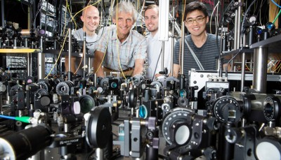 The Ketterle Group is working with lasers to create superfluids at MIT. Pictured, from left to right: grad student Colin Kenned, Professor Wolfgang Ketterle, grad student William Cody Burton, and grad student Woo Chang Chung. Photo: Bryce Vickmark